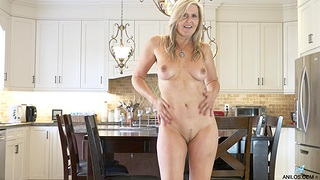 Naughty wifey Velvet Skye takes off her tights in the kitchen